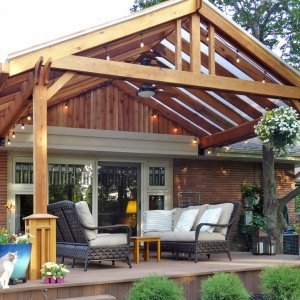 "Custom Pergola (Options: 11'-6"" L, 17' W, California Redwood, No Electrical Wiring Trim, 2 Post Anchor Kit for Gale-Wind, 1 Ceiling Fan Base, No Privacy Panels, No Curtain Rods, 9' Post Height, with Custom Boxes at the Bottom of the Posts, Transparent Premium Sealant). Customer requested transparent polycarbonate panels for roof. Yes, we can custom make your pavilion with any custom detail you like... Courtesy of Andy Goodrich of Mt. Prespect, IL."