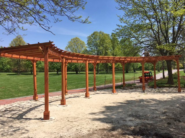 "Custom Fan Shaped Corner Pergola (Options: 50' x 12', California Redwood, Open Roof with Slats at 18"", No Electrical Wiring Trim Kit, 12-Post Anchoring for Concrete, No Ceiling Fan Base, 9' Posts, No Curtain Rods, Transparent Premium Sealant). Photo Courtesy of A. Amstutz of Toledo, OH."