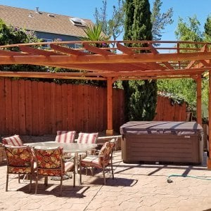 Custom Pergola (Options: 20' L, 13' W, Redwood, 1 Electrical Wiring Trim, 4 Post Anchor Kit for Gale-Wind, No Privacy Panels, Curtain Rods on 4 sides, 8.5' Post Height, Transparent Premium Sealant). Photo Courtesy of Chip Hansel of Brisbane, CA.