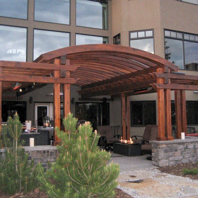"Custom Pergola (Options: 24' x 22', California Redwood, Open Roof with Rafters at 15"", 9' Post Height [Front Posts 2' Shorter], Transparent Premium Sealant). Photo Courtesy of Kelly Fraser of Okotoks, AB, Canada."