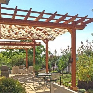Custom Pergola (Options: 35' L, 13' W, Redwood, No Electrical Wiring Trim, 4 Post Anchor Kit for Concrete, No Privacy Panels, No Curtain Rods, 10' & 11' Post Height, Transparent Premium Sealant). Photo Courtesy of D. Drake of Auburn, CA.