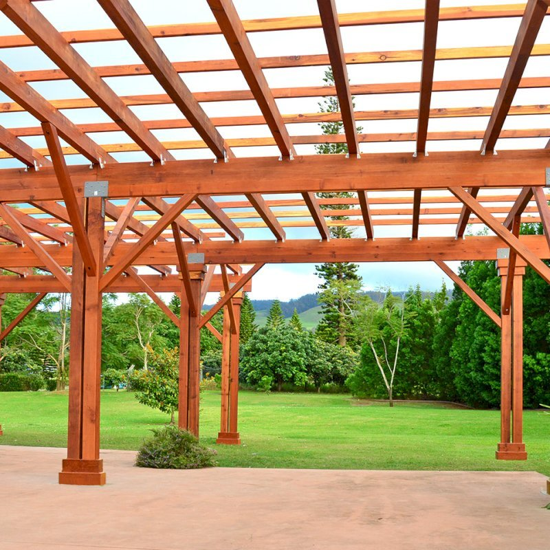 "Custom Pergola (Options: 39' x 50', Mature Redwood, 3 1/8"" x 15"" Glulam Beams/Supports, 3 3/4"" x 7 1/4"" Rafters and 1 3/4"" x 3 3/4"" Slats, Double 5 /12"" x 5 1/2"" x 10' Posts, Custom Hurricane Anchors, Transparent Premium Sealant). Photo Courtesy of D. Cole of Maui, Hawaii."