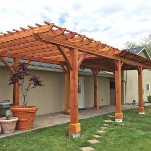 Custom Pergola (Options: 14' L x 12' W, Redwood, One Ceiling Fan Base, Electrical Wiring Trim Kit for 1 Post, Gale-Wind Anchors for 8 Posts, 8 x 8 Posts by Custom Request, Transparent Premium Sealant) with a 12' x 24' Shed Pavilion Attached. Photo Courtesy of G. Scotzin of Pasco, WA.