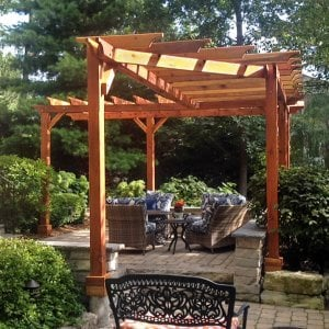 Custom Pergolas (Options: Custom designed L-shaped garden pergola. Roof size is 16' x 22 1/2' approximately on outer edge and 6' wide all around with a 45 degree cut on one end. Have 2x6 roof rafters spaced 18 inches on center with 2x2 slats spaced also 18 inches on center for initial drawing. Redwood, Trasnparent Premium Sealant)
