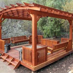 Custom Arched Pergola (Options: 18' x 18', with a Slope on the Roof, with Lattice Panels, with Deck and Railing by Custom Request, with a Bench Swing Seat). Photo Also Shows a Custom Storage Bench. Photo Courtesy of Bob P. of Westlake Village, CA.