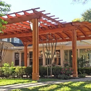 Custom Garden Pergola Attached to a Backyard Pavilion (Options:10' L x 15' W [Pavilion Size is 24' L x 16' Arc W], California Redwood, Unattached, 2 Post Electrical Wiring Trim, 6 Post Anchor Kit for Gale-Wind, With 2 Ceiling Fan Bases on Pavilion, No Privacy Panels, No Curtain Rods, 10 ft Post Height, Transparent Premium Sealant). Photo Courtesy of Jeff A. of San Ramon, CA.
