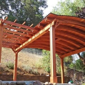 Custom Pergola with Pavilion (Options: Mature Redwood with Pavilion Ceiling in Old-Growth Redwood, with 2 Fan Bases, Electrical Wiring Trim Kit for 1 Post, 6-Post Anchor Kit for Gale-Wind, Transparent Premium Sealant). Backyard Pavilion is sized 18 x 18 ft and Garden Pergola is 9 x 14 ft. Yes, you can mix and match different pergola and pavilions in almost any size and configuration to make the perfect shade structure for your yard. Photo Courtesy of Joan Angwin of Morgan Hill, CA.