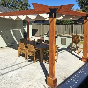 "Custom Pergola (Options: 20' L, 14' W, Redwood, 4 Post Anchor Kit for Concrete, No Privacy Panels, No Curtain Rods, 4"" x 8"" x 9.5' Post Height, Transparent Premium Sealant) with an Infinity Canopy Retractable Shade Structure. Photo Courtesy of M. Hall of San Jose, CA."