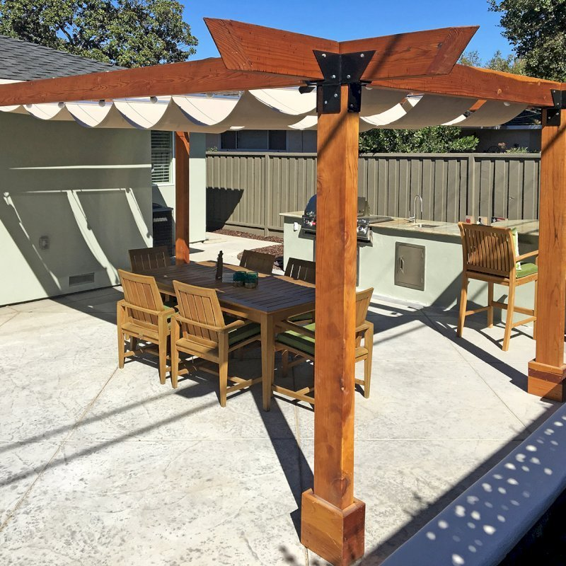 "Custom Pergola (Options: 20' L, 14' W, California Redwood, 4 Post Anchor Kit for Concrete, No Privacy Panels, No Curtain Rods, 4"" x 8"" x 9.5' Post Height, Transparent Premium Sealant) with an Infinity Canopy Retractable Shade Structure. Photo Courtesy of M. Hall of San Jose, CA."