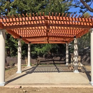Custom Pergola (Options: 19' x 32', Mature Redwood, 4-Post Kit for Hurricane, Trasnparent Premium Sealant). Customer Placed Tuscan Columns Around the Pergola Posts. Photo Courtesy of M. McCook of San Mateo, CA.