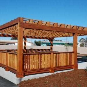 "Custom Pergola (Options: 24' x 24', Redwood, Open Roof with Slats at 18"", Rafters at 18"", 1¾"" x 9¼"" Supports and Rafters, 8 x 8 Posts, Transparent Premium Sealant). Photo Courtesy of Wanlass Park of San Pablo, CA."