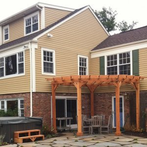 "Custom Pergola (Options: 16' L, 14' W, Mature Redwood, No Electrical Wiring Trim, Open Roof with Slats at 18"", Rafters at 18"", Lengthwise Roof Support Timbers, 4 Post Anchor Kit for Stone, No Privacy Panels, No Curtain Rods, 9ft Post Height, Transparent Premium Sealant ). Photo Courtesy of Deborah Pasik of Morristown, New Jersey."