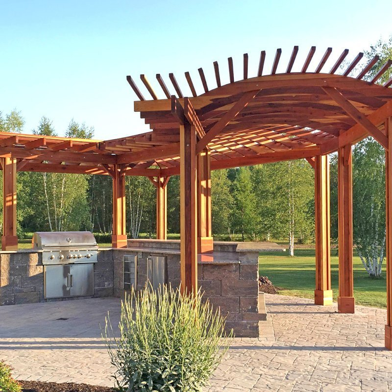 "Custom Pergola (Options: 33' L, 11'-6"" W, California Redwood, 1 Electrical Wiring Trim, 10 Post Anchor Kit for Concrete, No Privacy Panels, No Curtain Rods, 9' Post Height, Transparent Premium Sealant). Photo Courtesy of D. Pollock of Baldwinsville, NY."
