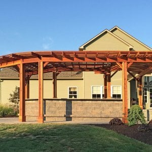 "Custom Pergola (Options: 33' L, 11'-6"" W, Redwood, 1 Electrical Wiring Trim, 10 Post Anchor Kit for Concrete, No Privacy Panels, No Curtain Rods, 9' Post Height, Transparent Premium Sealant). Photo Courtesy of D. Pollock of Baldwinsville, NY."