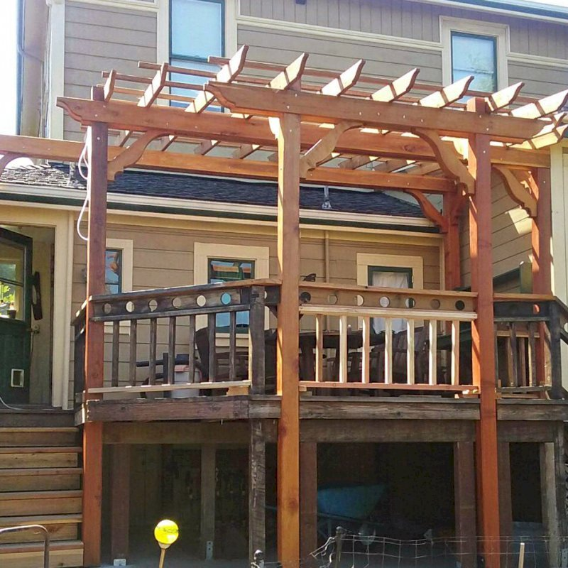 "Custom Garden Pergola (Options: 18' L x 13' W, California Redwood, Open Roof with Slats at 18"" Rafters at 18"" Roof Support Timbers, 6 Post Anchor Kit for Concrete, No Ceiling Fan Base, No Privacy Panels, No Curtain Rods, Custom 14' Post Height, Transparent Premium Sealant). Photo Courtesy of E. Seput of Benicia, CA."