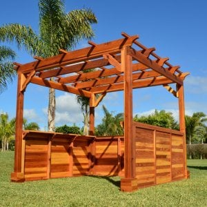 Custom Pergola (Options: 9 ft L x 9 ft W, California Redwood, 4-post kit for wood deck, No Ceiling Fan Bases, 3 Custom Solid Privacy Panels, No Curtain Rods, 7 ft Height Posts, Transparent Premium Sealant). Extra Custom Request: 2 Shelves.