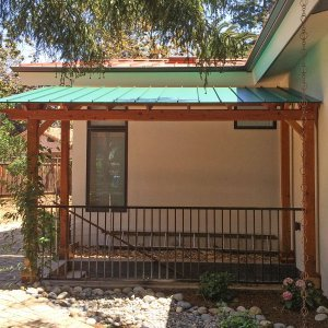 "Custom Pergola (Options: 8'-5"" x 15'-7"", Redwood, Flat Roof with 1x6 Tongue and Groove Boards and Metal Roof by Custom Request, Transparent Premium Sealant). Photo Courtesy of Steve A. of Atherton, CA."