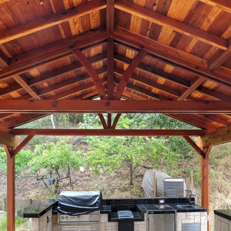 Del Norte Outdoor Kitchen Pavilion (Options: 22' L x 22' W, California Redwood, Unattached, 6 Post Anchor Kit for Stone, Brick or Concrete, No Electrical Wiring, 9 ft Post Height, No Ceiling Fan Base, No Privacy Panels, No Curtain Rods,Transparent Sealant). Photo Courtesy of El Laurel Resort of Baja, Mexico.