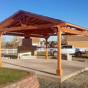 Del Norte Pavilion (Options: 22' L x 18' W, Douglas-fir, 4-Post Kit for Concrete, 1 Ceiling Fan Base, No Electrical Wiring Trim Kit, No Post Decorative Trim, Transparent Premium Sealant). Photo Courtesy of J. McDaniel of Brighton, Colorado.