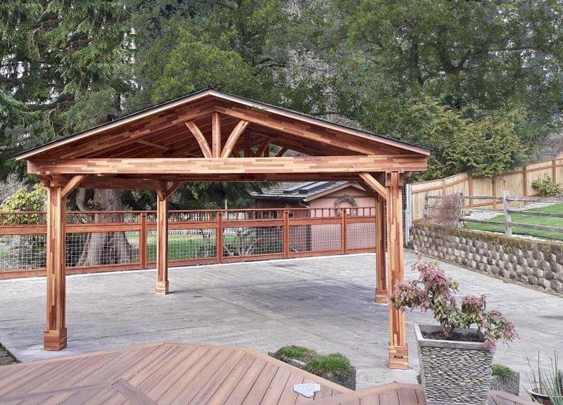 Del Norte Pavilion (Options: 18' L x 18' W, Mosaic Eco-Wood, 4-Post Kit for Concrete, No Ceiling Fan Base, No Electrical Wiring Trim Kit, Vertical Post Decorative Trim, Transparent Premium Sealant). Photo Courtesy of L. Foulk of Maple Valley, Washington.