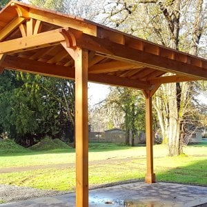 Custom Del Norte Pavilion (Options: 20' L x 10' W, Douglas-fir, 4-Post Kit for Hurricane, No Ceiling Fan Base, Transparent Premium Sealant). Larger lumber by custom request. Roofing was still pending when shots taken just after assembly. Photo Courtesy of S. Flanagin of Carnation, WA.