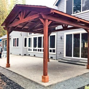 Del Norte Pavilion (Options: 16' L x 16' W, Mature Redwood, 4-Post Kit for Concrete, No Ceiling Fan Bases, No Electrical Wiring Trim Kit, No Post Decorative Trim, Transparent Premium Sealant). Photo Courtesy of D. Adams of Bellevue, WA.