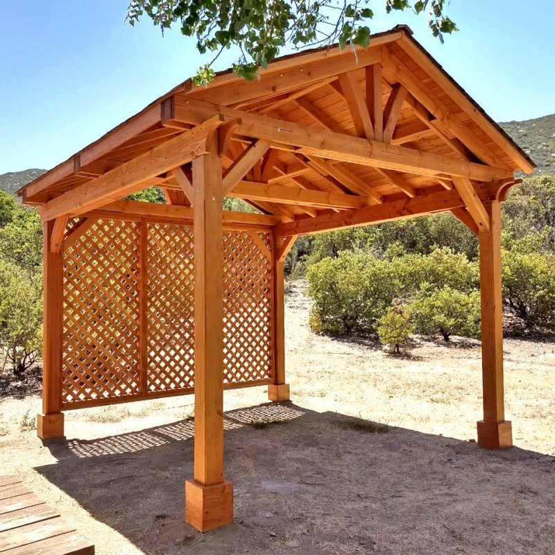 Del Norte Pavilion (Options: 12' L x 12' W, 1 Full Wall Lattice Privacy Panel, Douglas-fir, 4-Post Kit for Gale-Wind, No Ceiling Fan Base, No Electrical Wiring Trim Kit, No Post Decorative Trims, Transparent Premium Sealant). Photo Courtesy of J. Randall of Warner Springs, CA.