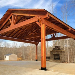 "Del Norte Pavilion (Options: 22' L x 22' W, Redwood, 4-Post Kit for Hurricane, With 2 Ceiling Fan Bases, Electrical Wiring Trim Kit for 1 Post, No Post Decorative Trim, Transparent Premium Sealant, 7 1/4"" x 7 1/4"" Posts & 1 1/2"" x 11 1/4"" Supports and Rafters by Custom Request). Photo Courtesy of B. Morales of Clayton, NC."