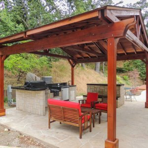 Del Norte Outdoor Kitchen Pavilion (Options: 18' L x 18' W, Redwood, Unattached, 4 Post Anchor Kit for Stone, Brick or Concrete, No Electrical Wiring, 9 ft Post Height, No Privacy Panels, No Curtain Rods, Transparent Sealant).