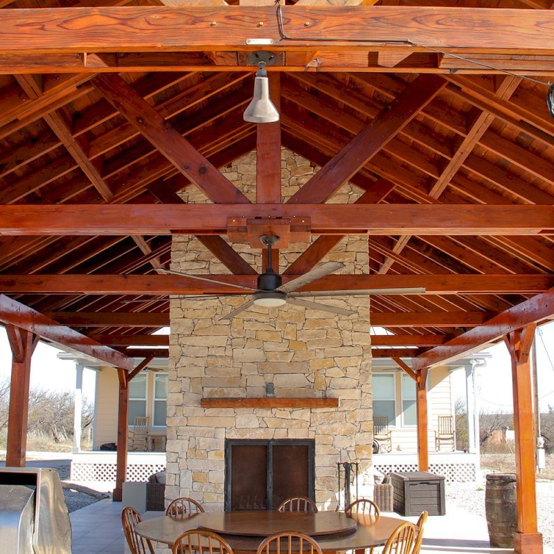 Del Rio Cathedral Ceiling Thick Timber Pavilion (Options: 42' L x 22' Triangle Base W, No Privacy Panels, Mature Redwood, 10' ft Height, Electrical Wiring Trim for 1 Post, 6-Post Hurricane Anchor Kit, No Post Decorative Trim, 2 Ceiling Fan Bases, No Curtain Rods, Transparent Premium Sealant). Note: Fireplace and kitchen counter was added after the Pavilion was installed by a Mason.  Forever Redwood does not do masonry work, but our designs can incorporate them.