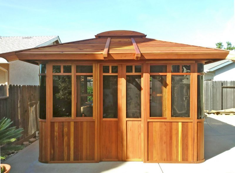 "DIY Wood Gazebo (14' L, 12' W, Redwood, All Sliding Windows with Screens, 4' x 6' Skylight, 36"" H Siding Below Windows, Vertical Siding, Japanese Doors with Screens, No Flooring, Transparent Premium Sealant). Photo Courtesy of B. Adkisson of Sacramento, CA. XL Custom Roof per Customer Request."