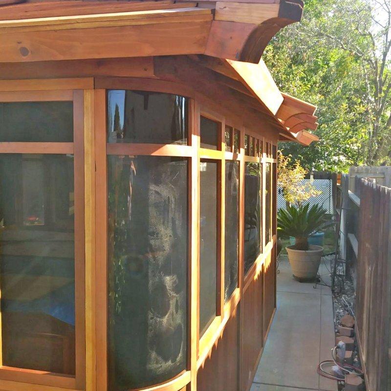 "DIY Wood Gazebo (14' L, 12' W, California Redwood, All Sliding Windows with Screens, 4' x 6' Skylight, 36"" H Siding Below Windows, Vertical Siding, Japanese Doors with Screens, No Flooring, Transparent Premium Sealant). Photo Courtesy of B. Adkisson of Sacramento, CA. XL Custom Roof per Customer Request."