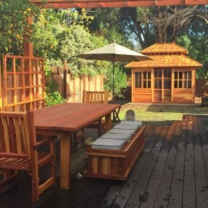 """Dream Gazebo (Options: 12' L, 10' W, Redwood, All Sliding Windows with Screens, 4' x 4' Skylight, 30"""" H Siding Below Windows, Horizontal Siding, Japanese Doors, Complete Floor, Set of Shingles, Transparent Premium Sealant). Photo also shows a San Francisco Patio Table with 2 Ruth Chairs, a Storage Bench and Mendocino Planters with Trellises. Photo Courtesy of Tina Phi of Palo Alto, CA."""