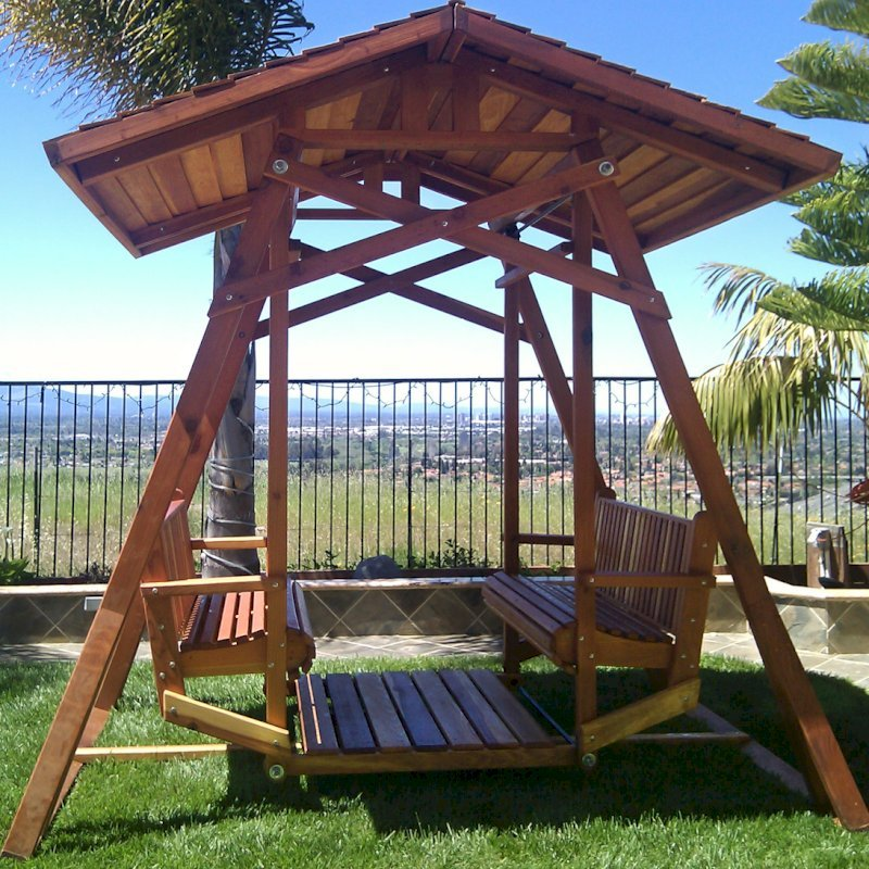 Dustin's Face to Face Glider (Options: California Redwood, XW Roof, Without Beverage Armrest, No Kid's Platform, No Engraving, Transparent Premium Sealant). Photo Courtesy of Teresa D. Ali of San Jose, CA.
