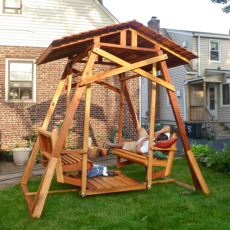 Dustin's Face to Face Glider after a hard day of assembly work (Options: California Redwood, Standard Roof, Without Beverage Armrest, No Kid's Platform/Sidetable, No Engraving, Transparent Premium Sealant). Photo Courtesy of Girish Sharma of Belleville, NJ.