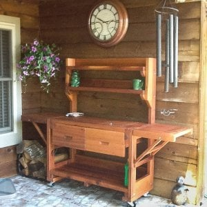 Eli's Potting Bench (Options: XL Size, Mature Redwood, Casters, 2 Shelves, Both Sides Fold Down, Copper Inset for Both Drawers, No Engraving, Removable Lid Over Right Drawer, Transparent Premium Sealant). Photo Courtesy of Linda Bond of Burkeville, Texas.