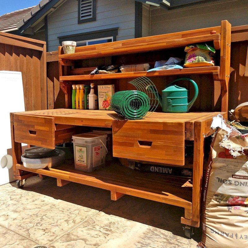 Eli's Potting Bench (Options: XXL Size, Mosaic Eco-Wood, With Casters, No Fold Down Sides, No Cooper Inset, With Two Shelves, Removable Slatted Lid Over Left Drawer, Transparent Premium Sealant). Photo Courtesy of N. Cabaud of Brentwood, California.