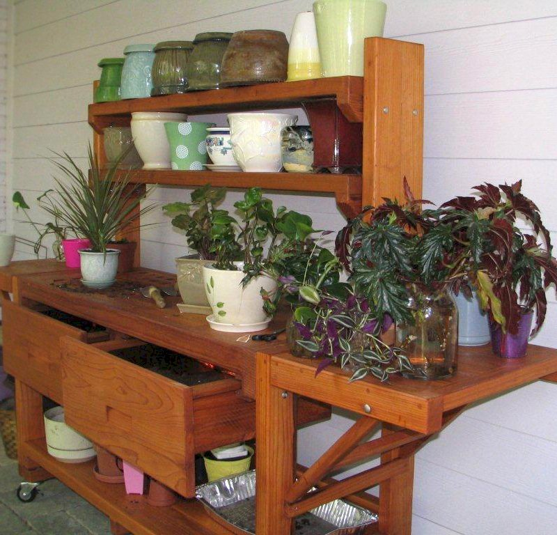 Eli's Potting Bench (Options: XL Size, Mature Redwood, Casters, 2 Shelves, Both Sides Fold Down, Copper Inset for Both Drawers, No Engraving, Removable Slatted Lid Over Left Drawer, Transparent Premium Sealant). Photo Courtesy of Leslie Hanna of Reston, Virginia.