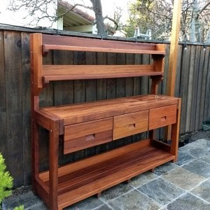 Eli's Potting Bench (Options: XXL Size, Old-Growth Redwood, No Casters, Two Shelves, No Fold Down Sides, No Cooper Inset, No Engraving, Removable Lid Over Right Drawer, Transparent Premium Sealant). Photo Courtesy of R. Cunningham of Sacramento, CA.