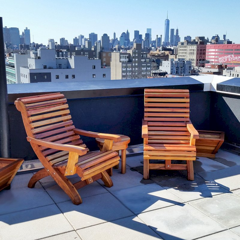 Ensenada Easychairs (Options: Standard Size, California Redwood, No Cushion, No Ottoman, Transparent Premium Sealant). Photo also shows 2 Tapered Planters and a Round Side Table. Photo Courtesy of Abe G. of Brooklyn, NY.
