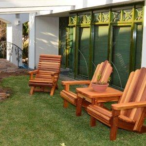 Ensenada Easychair (Options: Standard Size, Mature Redwood, No Cushion, No Ottoman, Transparent Premium Sealant) with an Adirondack Vignette Settee. Photo Courtesy of El Estero Beach Resort of Ensenada, Baja.