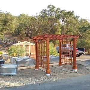 """Custom Entryway Arbor (Options: 120"""" W, 84"""" D, Redwood, 4-Post Archor Kit for Concrete, Transparent Premium Sealant) with 6 x 6 Posts and 2 x 6 Rafters by Custom Request. Photo Courtesy of K. Moore of Healdsburg, CA."""