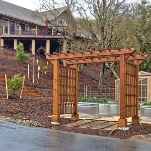 "Entryway Arbor (Options: 120"" W, 84"" D, Redwood, 4-Post Archor Kit for Concrete, Transparent Premium Sealant) with 6 x 6 Posts and 2 x 6 Rafters by Custom Request. Photo Courtesy of K. Moore of Healdsburg, CA."