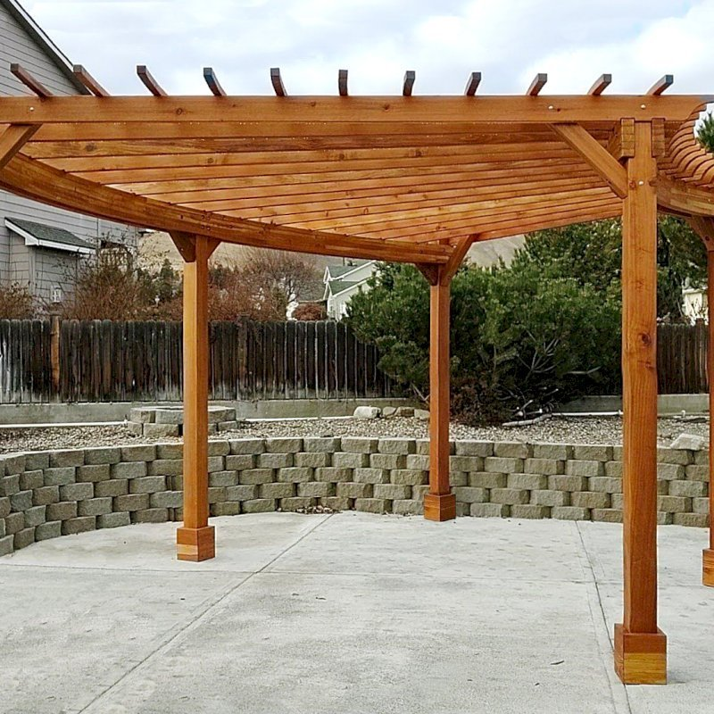 Fan Shaped Pergola Kit (Options: 22' x 20', California Redwood, With Roof Slats, No Electrical Wiring Trim Kit, 5-Post Anchoring for Concrete, No Ceiling Fan Base, 9.5' Posts, No Curtain Rods, Transparent Premium Sealant). Photo Courtesy of J. Knuvson of Wenatchee, Washington.