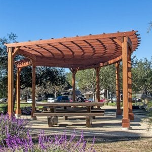 Fan Shaped Pergola Kit (Options: 35' x 16', Mature Redwood, With Roof Slats, No Electrical Wiring Trim Kit, 8-Post Anchoring for Concrete, No Ceiling Fan Base, 9.5' Posts, No Curtain Rods, Transparent Premium Sealant). Photo Courtesy of M. Roberts of Carpinteria, California.