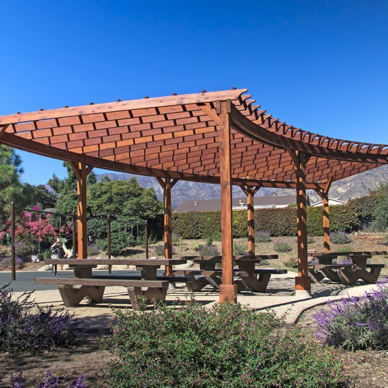 Fan Shaped Corner Pergola (Options: 35' x 16', Mature Redwood, With Roof Slats, No Electrical Wiring Trim Kit, 8-Post Anchoring for Concrete, No Ceiling Fan Base, 9.5' Posts, No Curtain Rods, Transparent Premium Sealant). Photo Courtesy of M. Roberts of Carpinteria, California.