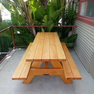 "Forever Picnic Table (Options: 6' L, 24"" W (Custom details: Benches and tabletop narrower [benches only 10"" W vs 11 1/2"" W standard - tabletop only 24"" W vs 28 1/4"" standard]) and placed closer to table to create more walking room in limited space), Attached Side Benches, Douglas-fir, Standard Tabletop, Slightly Rounded Corners, No Umbrella Hole, Transparent Premium Sealant). Photo Courtesy of T. Stockton of Ventura, CA."