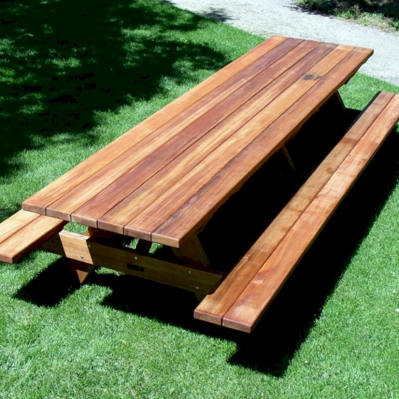 "Forever Picnic Table (Options: 12' L, 34 1/2"" W, Side Benches, Mature Redwood, Standard Tabletop, Slightly Rounded Corners, No Umbrella Hole, Transparent Premium Sealant)."