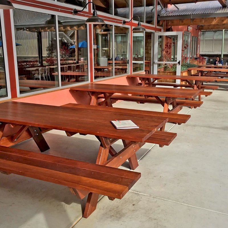 Custom Picnic Tables (Options: Old-Growth Redwood, Benches Extra Wide by Custom Request, Transparent Premium Sealant). Photo Courtesy of Chow's Restaurant in 3770 Piedmont Avenue, Oakland, CA.