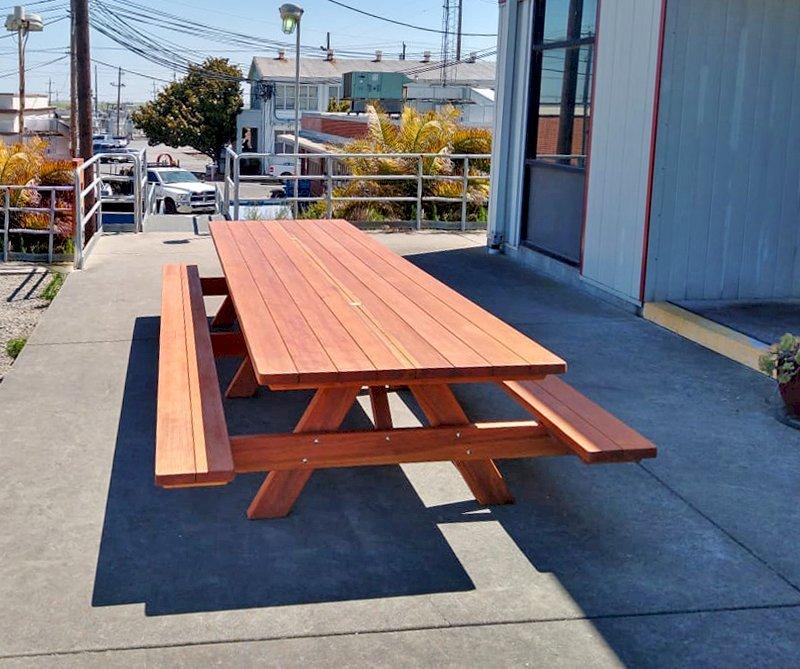 "Custom Picnic Table (Options: 14' L x 48"" W, California Redwood, Standard Tabletop, 2 Umbrella Holes, Transparent Premium Sealant). Photo Courtesy of E. Lagare of Martinez, CA."